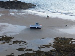 Boat on beach in St. Malo